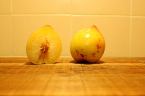 The Lemon Pear, halved and whole.